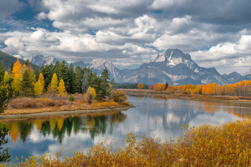 Alpine lake and colorful trees with reflection and mountain landscape