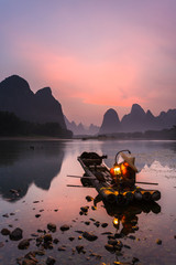 Cormorant fisherman on the Li River, near the town of Xingping in Guangxi province, China. This area is renowned for its Karst topography.
