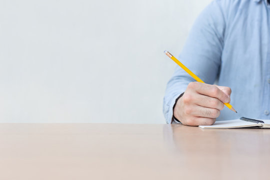 high school,university student study.hands holding pencil writing paper answer sheet.sitting lecture chair taking final exam
