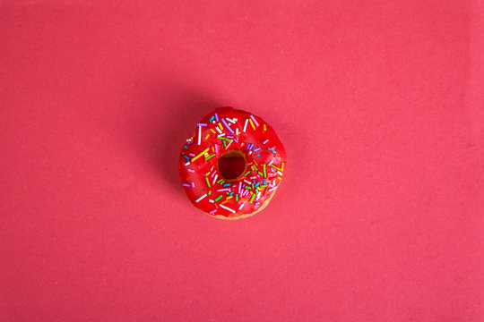 colorful doughnuts red background studio