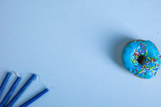 colorful doughnut candels blue background studio