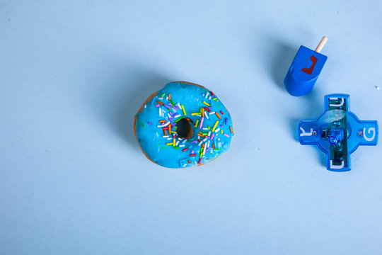 colorful doughnut dreidel blue background studio