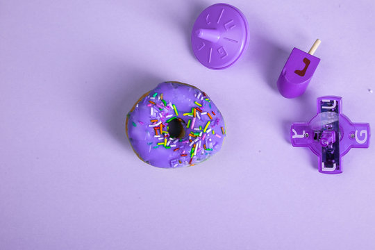 colorful doughnut dreidel purple background studio