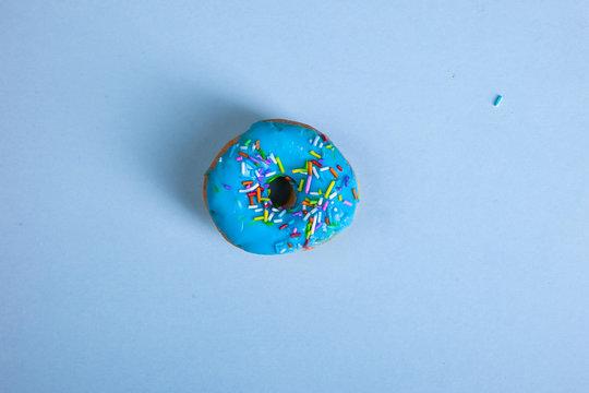 colorful doughnut blue background studio