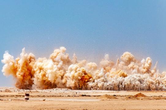 Dust clouds after detonator blast in the desert