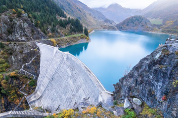 Foto auf Gartenposter Wasserfalle Reservoir lake and water dam in French Alps to produce hydroelectricity, sustainable development using renewable energy and hydropower