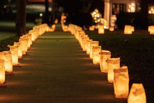Candle lit residential sidewalk on Christmas Eve