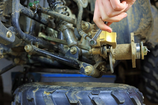 Mechanic Carrying Out Repairs On A Quad Bike