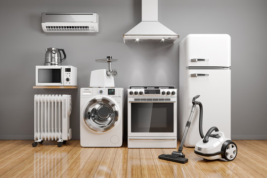 Set of home kitchen appliances in the room on the wall background.