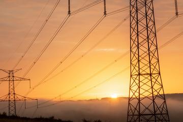 high voltage post,High voltage tower sky surise background