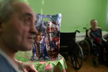Residents of a nursing home are seen during a visit of volunteers on the occasion of the Christmas and New Year holidays, in Omsk region