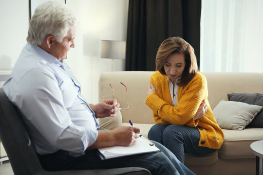 Professional psychotherapist working with patient in office