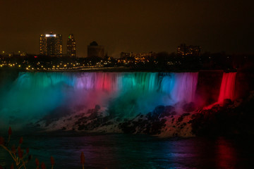 Colorful and bright long exposure of Illuminated American Falls in Niagara Falls at night
