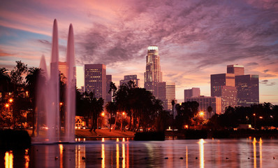 Long exposure of Los Angeles Downtown Skyline Seen from Echo Park with the Echo Park Lake fountain in the foreground