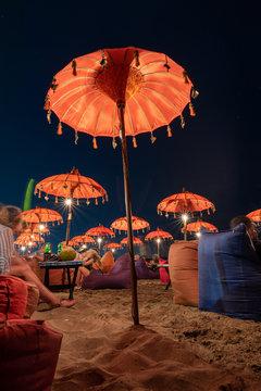 long exposure of the kuta beach bar umbrellas at night