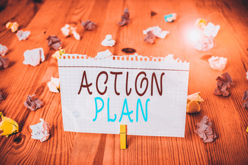 Text sign showing Action Plan. Business photo text detailed plan outlining actions needed to reach goals or vision Colored crumpled papers empty reminder wooden floor background clothespin