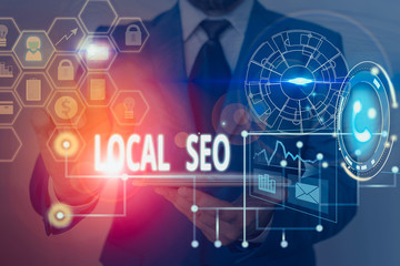 Writing note showing Local Seo. Business concept for helps businesses promote products and services...