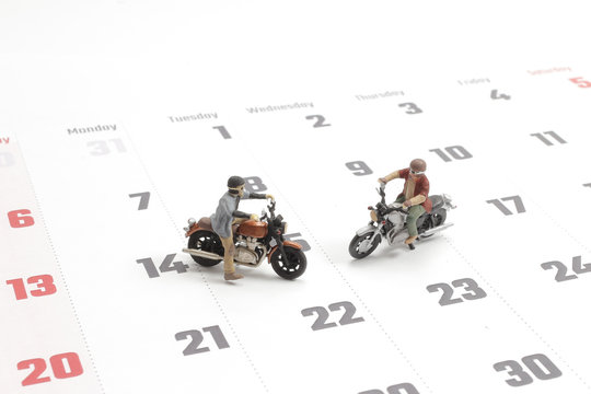 Close up of two traveler miniature figure ride motocycle
