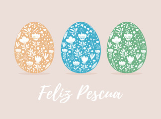 Happy Easter-Feliz Pescua, Spanish Easter Wishes. Cute Eggs in 3 Diferent Colors Isolated on a Beige Background. Pale Yellow, Blue and Green Eggs with and White Hand Drawn Floral Ornament Inside.
