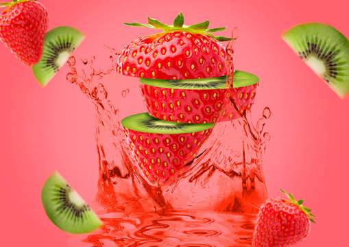Hybrid Strawberry and Kiwi. Sliced strawberries with a center of kiwi on a pink background with kiwi slices, strawberries and juice.