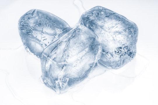 Melted  ice cubes isolated on white background