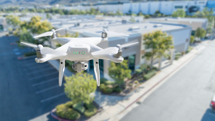 Unmanned Aircraft System Quadcopter Drone In The Air Near Corporate Industrial Building Wall mural