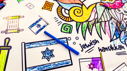 Childrens drawing of flag of Israel with the blue pencil and inscription JEWISH and HANUKKAH. Hannukah and jewish concept and symbol.