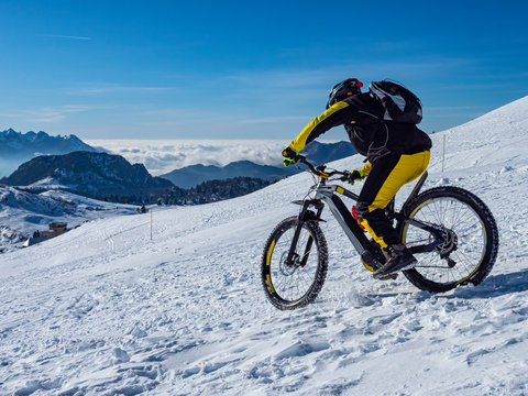 Mountain bike in the alps in the snow