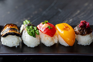 Foto op Aluminium Sushi bar Vegan sushi with tomato, mushroom and aubergine