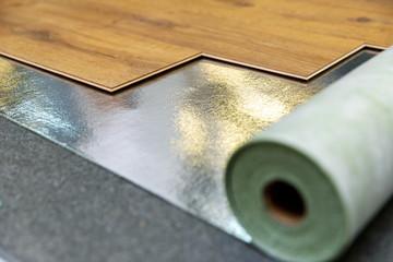 laminate floor installation in a room on foil underlay