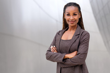 Beautiful female african american business woman CEO, legal, financial, attorney, confident with arms folded