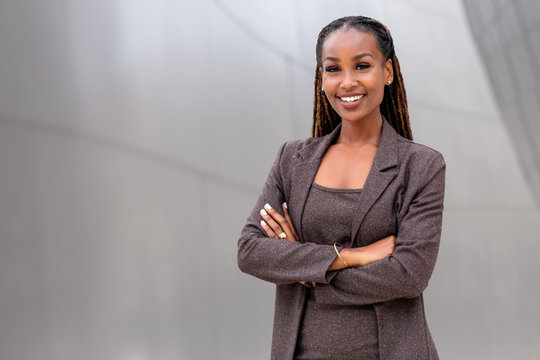 Warm, friendly, beautiful cheerful african american executive business woman at the workspace office