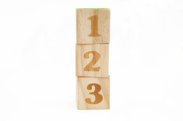 wooden blocks stacked with the numbers 123 isolated on white background Wall mural