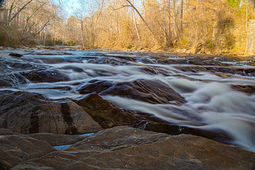 Sope Creek in Atlanta Georgia with rocks in the foreground to the side
