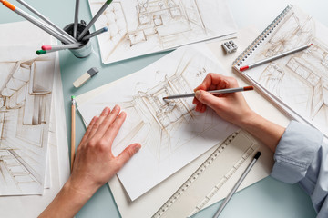Interior designer making hand drawing pencil sketch of a bathroom