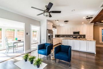 Open floor plan remodel with kitchen, living, sunroom, workspace