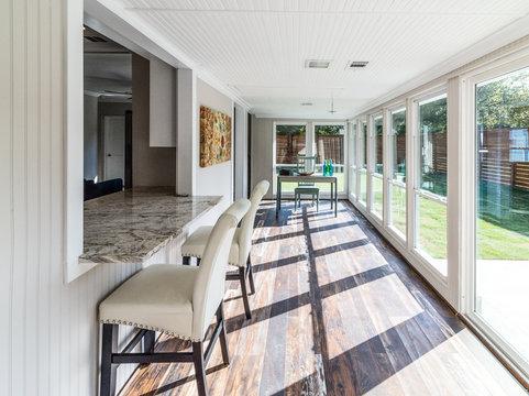 Workspace in sunroom, natural light, remodel