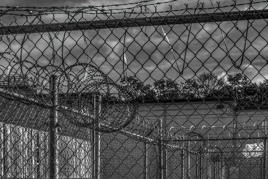Scenes inside Kingston Penitentiary steel fencing razor wire barbed wire nobody