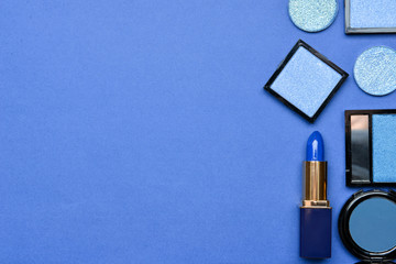 Set of blue makeup cosmetics on color background Wall mural