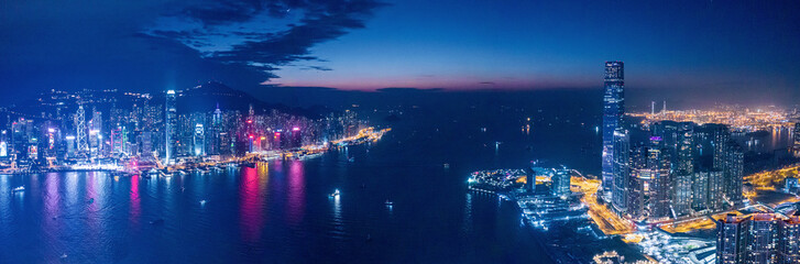 Fototapete - Amazing cityscape night view of Victoria Harbour, Hong Kong