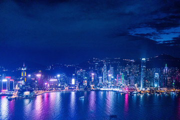 Fototapete - Iconic cityscape night view of Victoria Harbour, Hong Kong