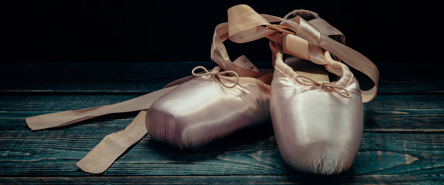 Pointes ballet shoes. Against a dark background.
