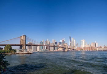 Brooklyn bridge, New York, USA - September 2019: [ Brooklyn bridge architecture with panoramic view of New York City and lower Manhattan, One World Trade Center, Dumbo ]