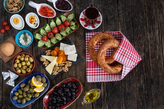 Traditional Turkish breakfast with Turkish bagel simit on the table