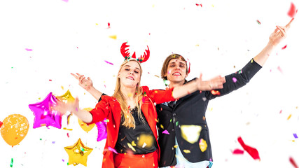 young couple enjoy dance with colorful confetti in new year celebration party