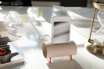 Practical solutions; toilet paper roll speaker and smart phone holder.