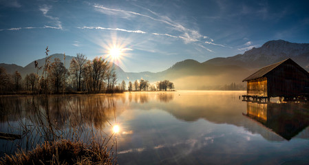 Poster Zwart Idyllic Morning Sun view to the Bavarian Kochelsee