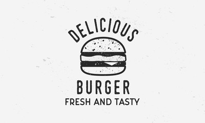 Delicious Burger - vintage logo template with burger silhouette and grunge texture. Vector illustration