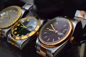 Luxury watches placed on a glittering glass floor Wall mural