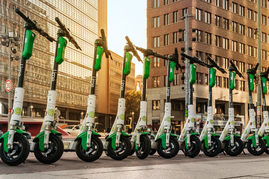 Row of electric E scooters , escooter or e-scooter of the company LIME  - Berlin, Germany, October, 2019